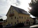 Dachsanierung und Aufstockung Wohn- und Geschäftshaus